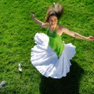 Model in a white skirt twirls on the grass | San Jose, USA