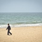 Businessman walks on the Haeundae Beach | Busan, South Korea
