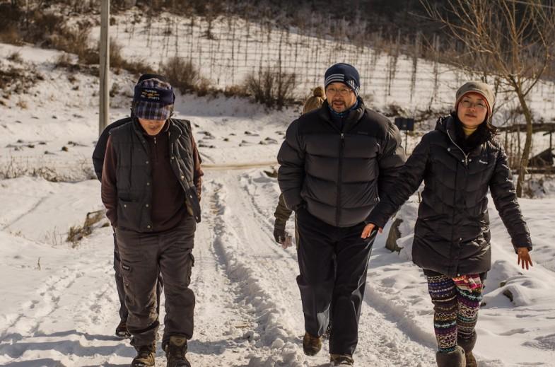 Korean Natural Farmers, Seonghyun Choi (최성현) and Ryosok Hong (홍려석) walking along the farmland (2013, P.M. Lydon)