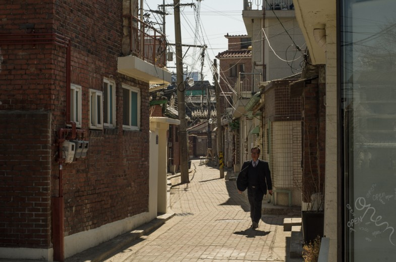 Man walks down an alley in the Pirun-dong neighborhood of Seoul, South Korea (photo: P.M. Lydon | 2013)
