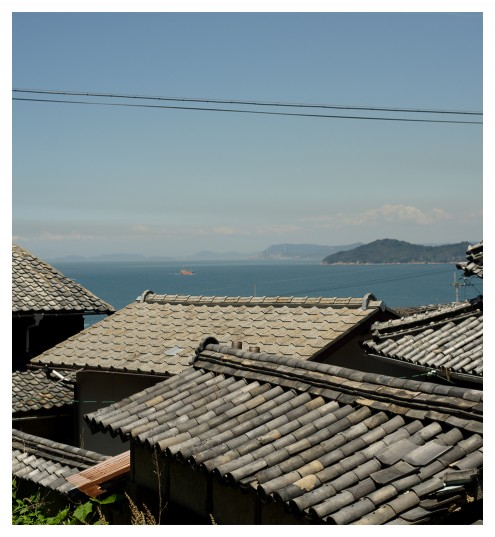 Rooftops of Ogijima, with the Seto Inland Sea in the distance.