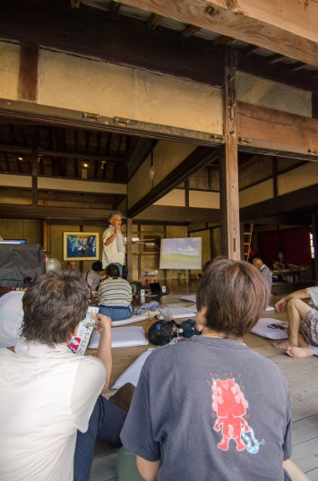 Farmer Kohno san lecturing at the HUMAN:NATURE Symposium in Megi House, Megijima, Japan