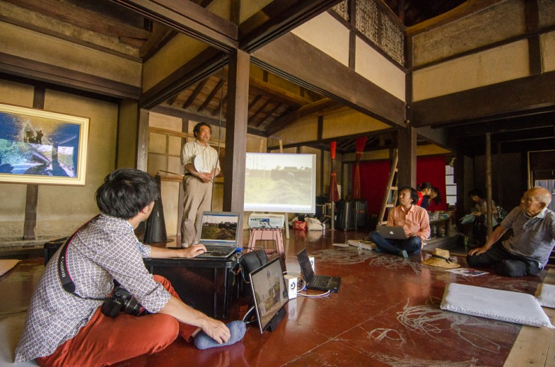 Farmer Okitsu san lecturing at the HUMAN:NATURE Symposium in Megi House, Megijima, Japan